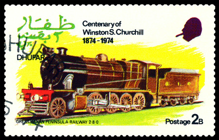30 s: STAVROPOL, RUSSIA - MARCH 30, 2016: A Stamp printed in the  Dhufar  shows steam locomotive, Great Indian Peninsula Railway 2-8-0, stamp devoted to the   Centenary of Winston S. Churchill, circa 1974