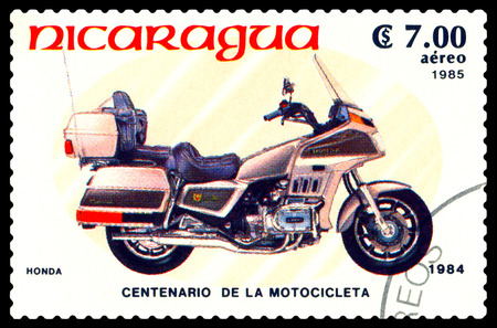 centenary: STAVROPOL, RUSSIA - MAY 24, 2016: a stamp printed in Nicaragua, shows an motorcycle Honda,  stamp devoted to the centenary of the invention of motorcycle , cirka 1984