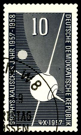 gdr: STAVROPOL, RUSSIA - APRIL 30, 2016: a stamp printed  in  GDR  shows first Sputnik, circa 1957 Editorial