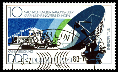 gdr: STAVROPOL, RUSSIA - July 08, 2016: a stamp printed by GDR shows  Cable-Laying Vechcle, Dish Antenna , circa 1980 Editorial