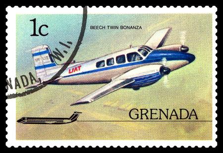 philately: STAVROPOL, RUSSIA - October 10, 2016: a stamp printed in Grenada, shows  plane Beechcraft Twin Bonanza 1952,  circa 1976. Editorial