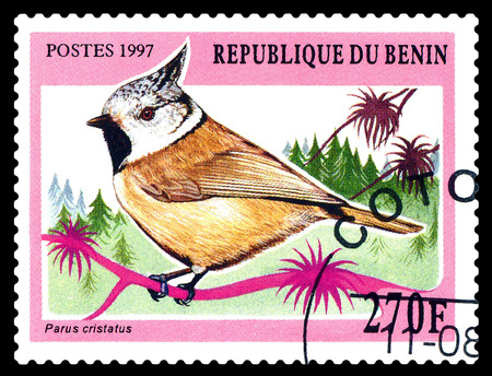 STAVROPOL, RUSSIA - December 11, 2016: A stamp printed by Benin shows bird an Tufted titmouse (Parus Cristatus), circa 1997