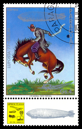 STAVROPOL, RUSSIA - September 12, 2017: a stamp printed by Paraguay shows Tamer of wild horses, International air mail mail