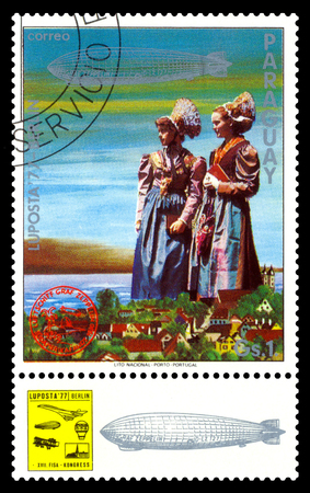STAVROPOL, RUSSIA - September 12, 2017: a stamp printed by Paraguay shows German Girls in Traditional Costumes, International air mail mail Editorial