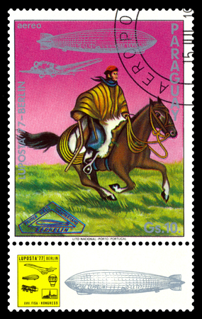 STAVROPOL, RUSSIA - September 12, 2017: a stamp printed by Paraguay shows Argentinian Gaucho, air mail exhibition