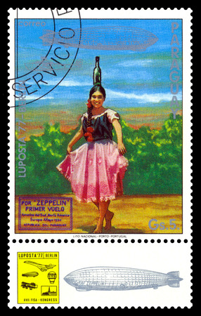 STAVROPOL, RUSSIA - September 12, 2017: a stamp printed by Paraguay showsIndian Girl in Bottle Dance Costume, air mail exhibition Editorial