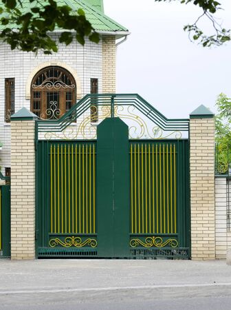 Facade and decorative gates are green.