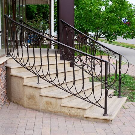 Modern iron railings and stairs. Entrance to the building.