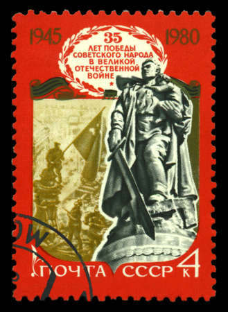 STAVROPOL, RUSSIA - May 31. 2020: A stamp printed in USSR shows Monument to a Russian soldier with a German girl in her arms. Berlin, Treptow Park, circa 1980