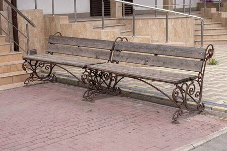 Modern benches for relaxing on a city street.