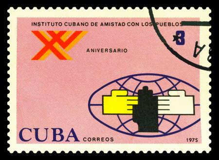 STAVROPOL, RUSSIA - July 25.2020: A Stamp printed in the Cuba shows 15 th anniv. Peoples Friendship Institute of Cuba, circa 1975