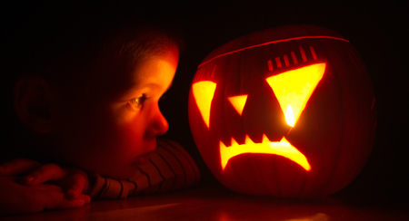 boy and haloween mask in the dark