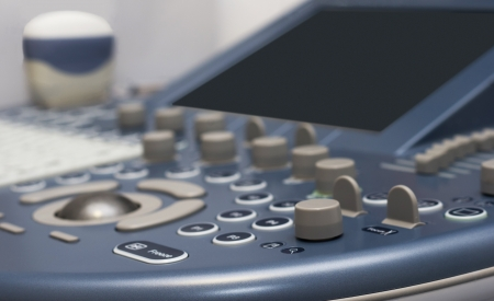 detail of ultrasound control buttons with ultrasound probe on background