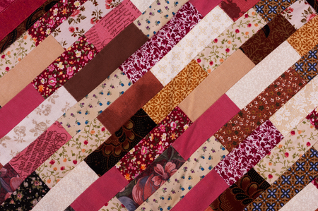 red and brown quilt patchwork texture background