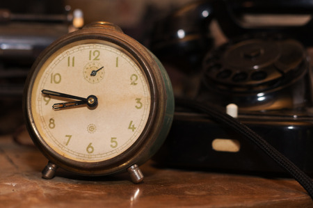 old desk: Old retro clock on desk with old telephone