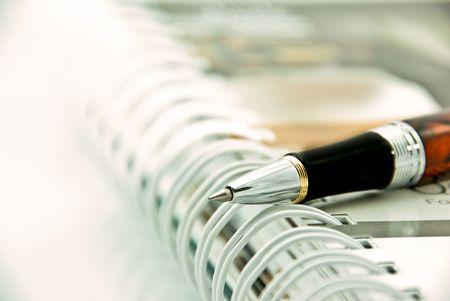 Pen point on organizer Stock Photo