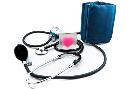Stetoscope and Sphygmomanometer around a heart, two essentials for it's health care. Stock Photo - 11123982
