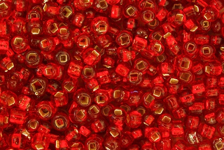 seed beads: A Macro of a ruby red seed beads pattern