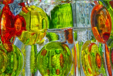 A closeup background of some colorful glass and its reflections Stock Photo