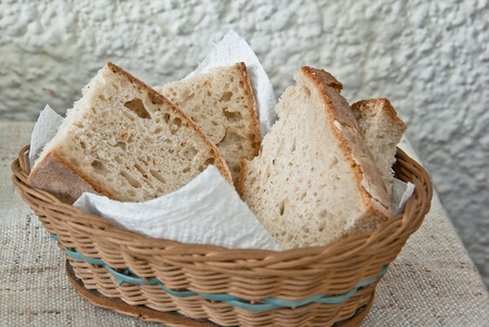 Fresh homemade bread in a basket ready fot the table