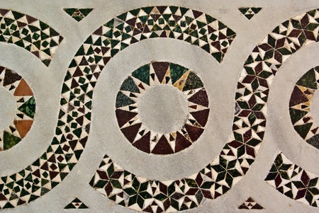 Striking stylised repetitive inlaid geometric design, ornamental architectural background photo