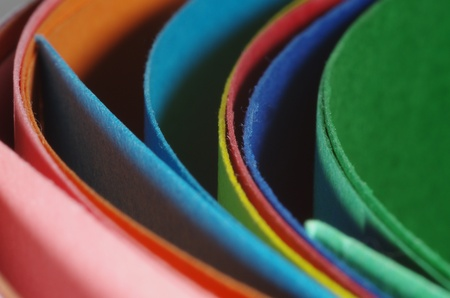 An overhead abstract view of colourful curved cardboard folders for office or school. Stock Photo