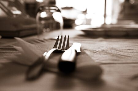 implements: Abstract Background Knife And Fork table setting in sepia monotone with shallow dof