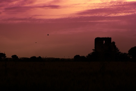 Sunset Over Silhouetted Town with delicate pinky maroon sky