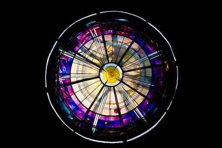 Colorful stained glass texture in a round window