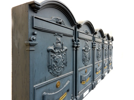 diminishing: Five ornate metal mailboxes with Coat of Arms in a diminishing row isolated on white.
