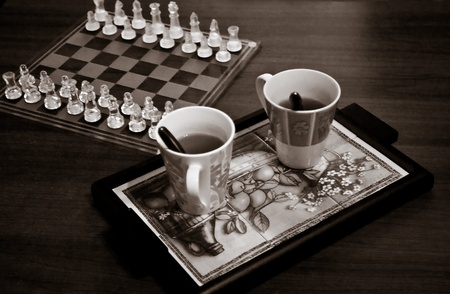 Chess And Coffee For Two, two mugs of hot black coffee wait alongside a chessboard for the players.