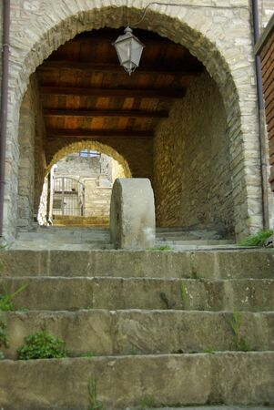 Stone steps leading to an empty undercover arched walkway, architectural detail Stock Photo