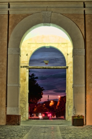 sunset through ancient city door