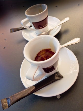 hot coffees: two coffee cups with sugar and spoons