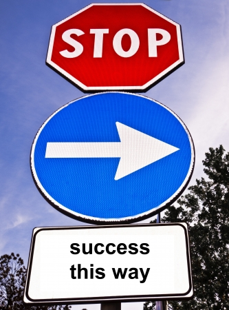 Signpost with three different traffic signs, a red octagonal stop sign, a blue circular right pointing arrow and a blank white rectangular sign saying Success This Way