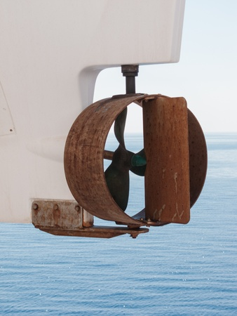 Small round rusty propellor on a lifeboat hanging suspended on a passenger liner Stock Photo