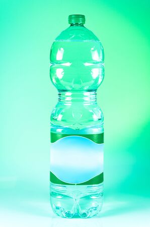 green bottle made with recycled plastic RPET, eco friendly photo