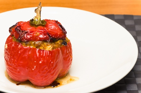 Delicious savoury roasted stuffed red bell pepper served as an individual portion or appetiser on a plate Stock Photo - 17481649