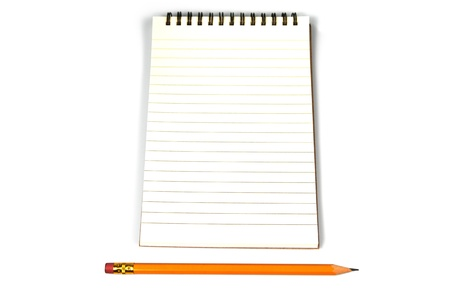 A spiral bound notebook open at a page of blank lined paper with a wooden pencil lying below parallel to the bottom of the page on a white background Stock Photo
