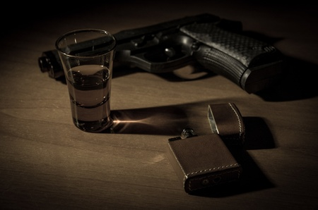 noir desk, with gun schotch and vintage lighter