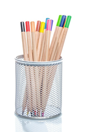 desk tidy: Collection of wooden coloured pencils in the colours of the rainbow or spectrum standing upright in a wire mesh a desk tidy on a white background