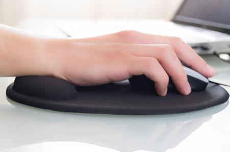 human wrist: close-up of a working at the computer situation