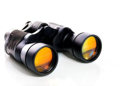 handheld: Black binoculars with orange lens isolated on white background Stock Photo