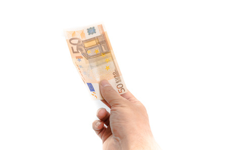 Mans main tenant un billet de 50 euros Banque d'images