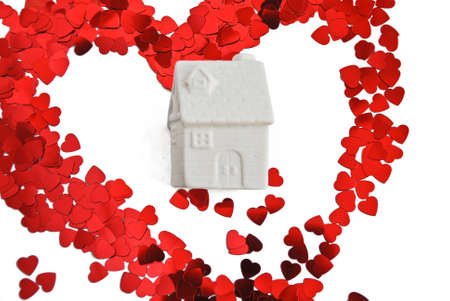 Home sweet home Model of an house in white colour with big red heart and white  photo