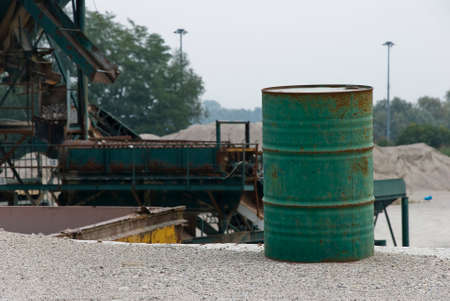 gravel pit: A empty green can-oil in a gravel pit