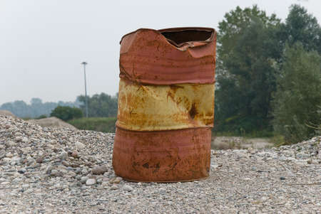 gravel pit: A empty brown can-oil isolated in a gravel pit Stock Photo