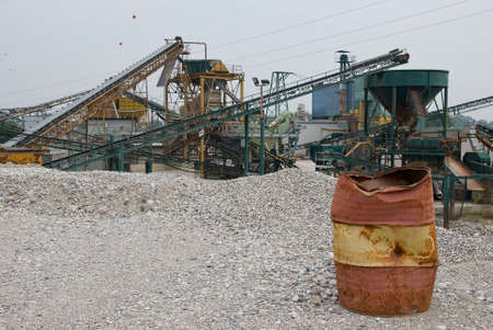 gravel pit: A empty brown can-oil in a gravel pit