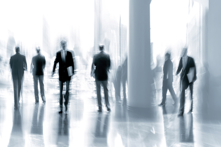 tonality: abstakt image of people in the lobby of a modern business center with a blurred background and  blue tonality