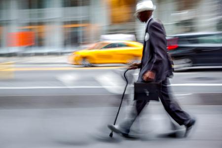 blurred movement disabled on a city street  Reklamní fotografie